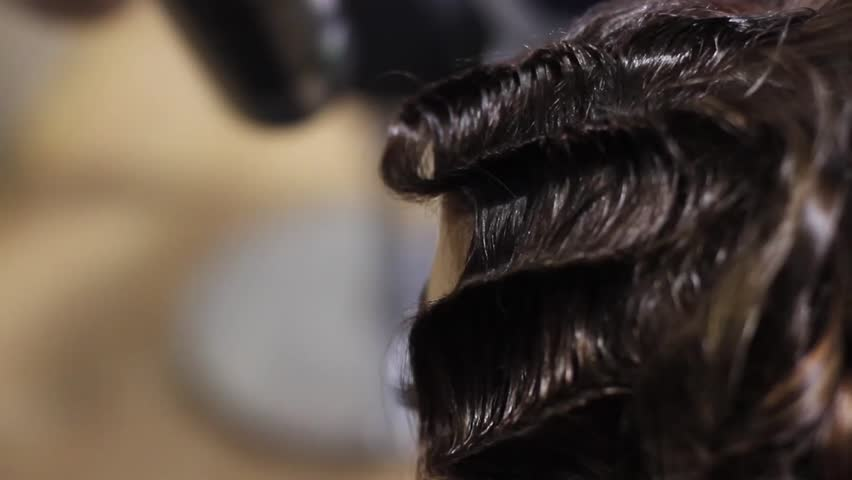 Footage of barber making a hairstyle on womans head - HD stock footage clip