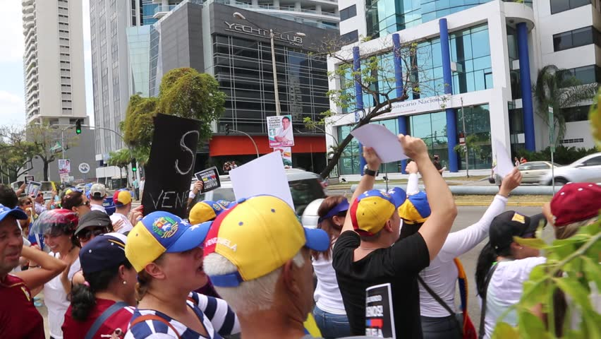 Panama City, Panama, Circa 2013: Venezuelans residents in hold up signs of protest against their own government along the streets of Panama City, Panama, Circa 2013 - HD stock footage clip