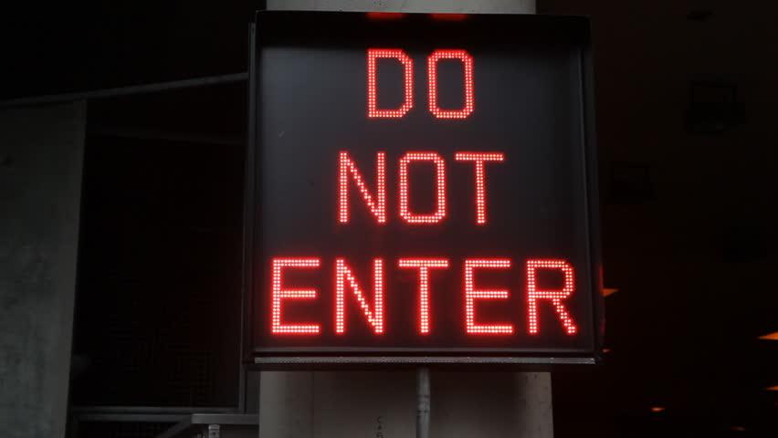 Do Not Enter Garage : Do not enter wide flashing neon sign
