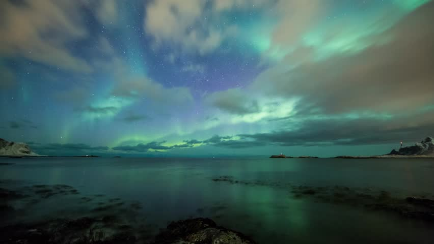 Northern lights (Aurora borealis) in Norway over a beach