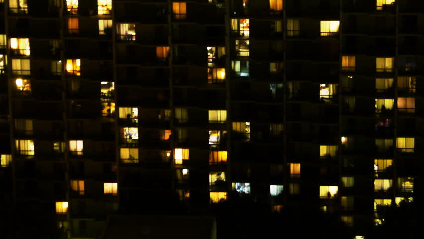 Time Lapse of Apartment Building at Night -Zoom Out-