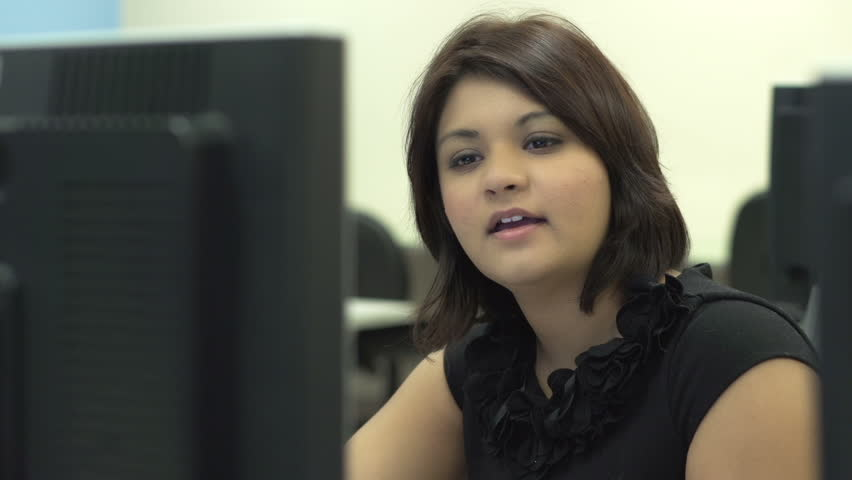 Bored female at computer laughing