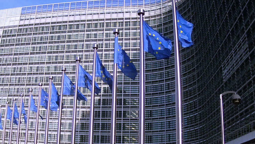 European Flags floating in front of the European Commission in Brussels.