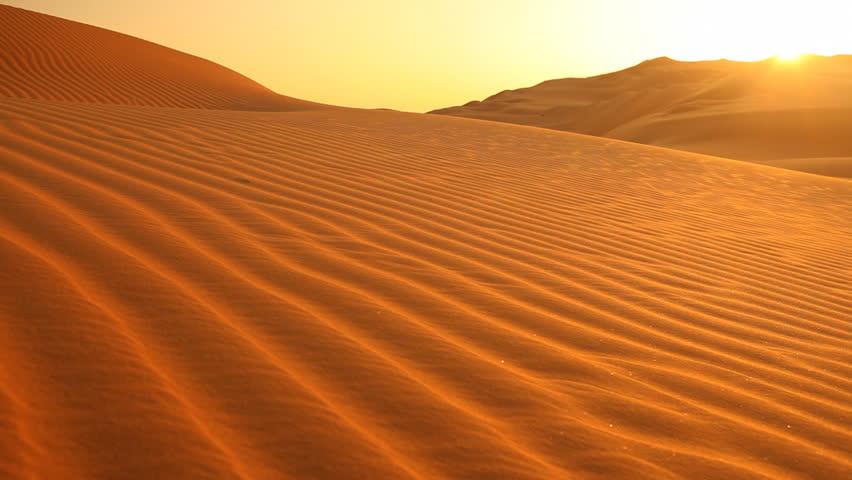 sunset in desert with light wind, loop