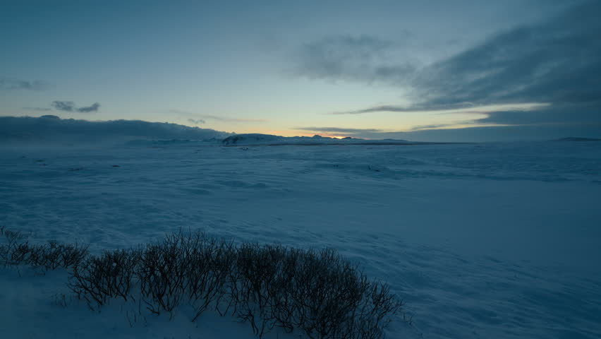 Timelapse of the sunrise in a snowy field in Iceland