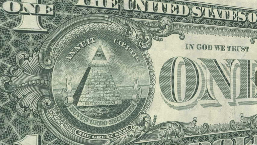 The All Seeing Eye on the back of the US Dollar Bill glows and emits rays of light as the camera draws closer. - HD stock video clip
