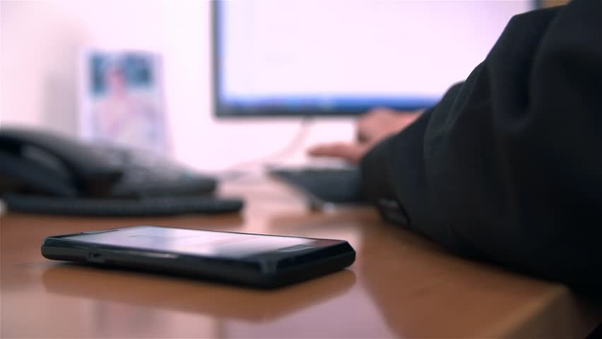 Office Worker Picking Up Mobile Phone in Slow Motion
