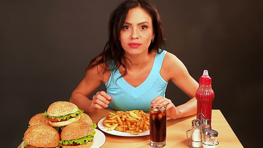 Woman eating fast food.Time lapse