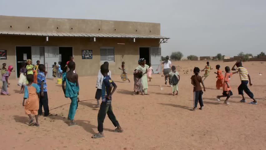 MATAM,SENEGAL-CIRCA NOVEMBER 2013:Actress Caterina Murino running plays with the children of a primary school,Caterina Murino is the testimonial of the NGO AMREF,circa November 2013.
