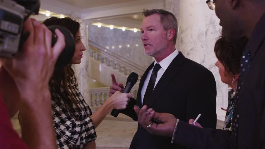 News crew interviews politician inside building - 4K