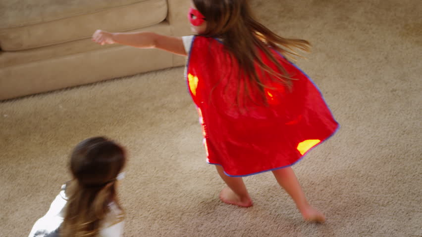 Young girls dressed as superheroes playing at home - 4K