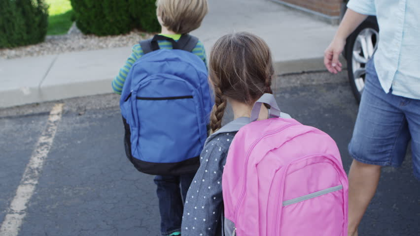 Kids getting out of car and going to school - 4K
