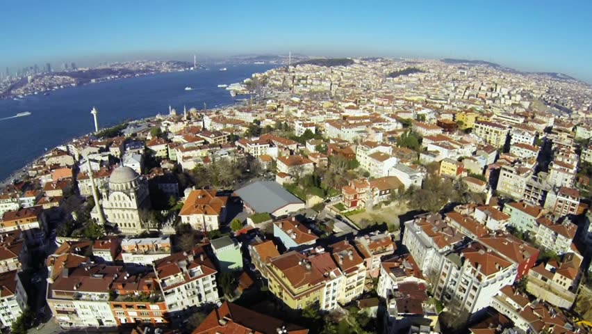 Birds eye view of many luxury houses and a swimming pool at Salacak iskele arkasi sokak. Aerial video footage of a residential housing community in Istanbul.