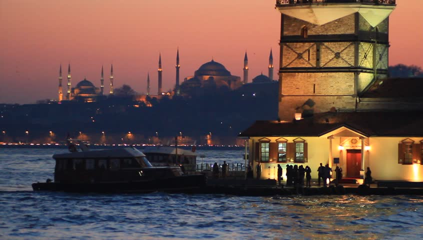 Maidens Tower on sunset. Close View. Istanbul landmarks Blue Mosque, Hagia Sophia and Topkapi Palace in the distance.