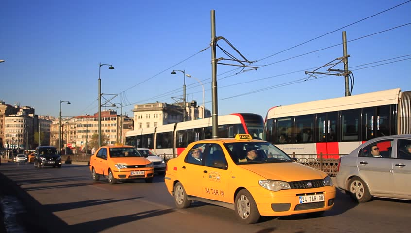 ISTANBUL - MARCH 31, 2014: Heavy traffic on Galata Bridge. Due to increasing traffic & air pollution, Istanbul became one of most polluted city also planned for return of tram.