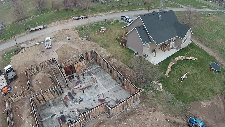 Aerial new home construction rural community new home for Basement foundation construction
