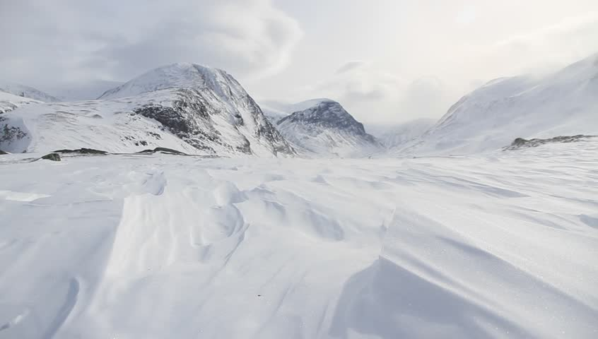 Wind blowing over the snow (spin drift) in the mountains of Lapland, Sweden.