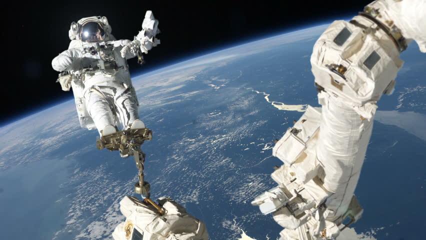 Astronaut repairing satellite on crane - HD stock footage clip