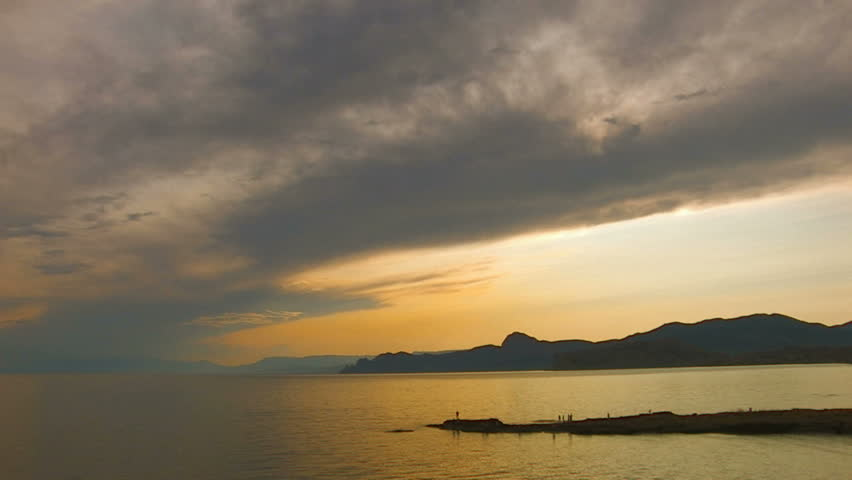 HD sea and rocks at sunset with clouds, Crimea, Koktebel, Canon XH A1, FullHD video, 1080p, 25fps, progressive scan