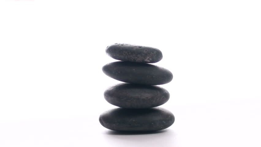 Stacking Zen rocks against white background - HD stock video clip