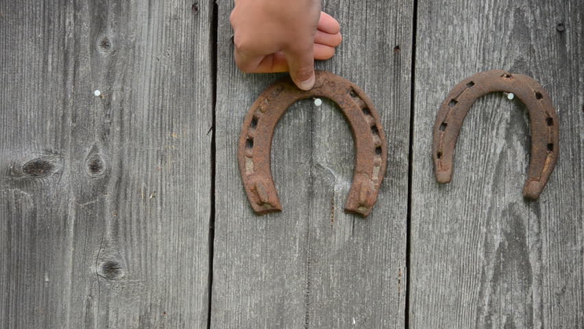 Hand Hang Retro Rusty Horse Shoe On Rural Wooden House