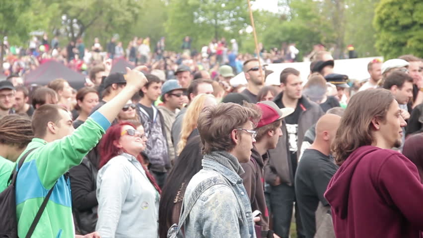 PRAGUE, CZECH REPUBLIC - MAY 10, 2014: People standing and dancing in front of the musical stage at Marijuana freedom protest festival