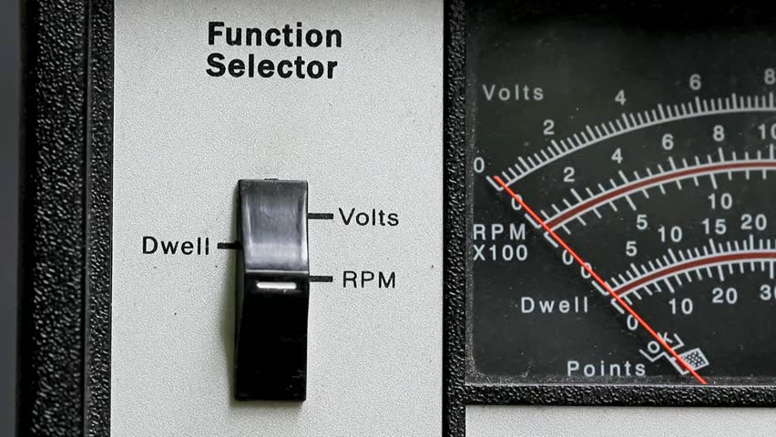 Analog Meter Needle : Close up of analog combination dwell volt and tachometer