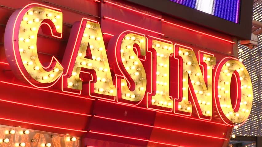 LAS VEGAS, NV - CIRCA 2014: Flashing CASINO sign at entrance.