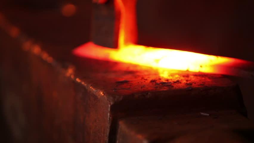 Blacksmith Strikes Red Hot Iron, Sparks Fly, Medium Shot ...