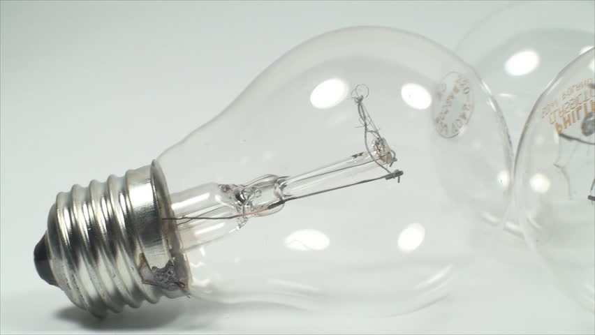 Economic Light Bulb On A White Background Power Light Eco Friendly Pan Stock Footage Video