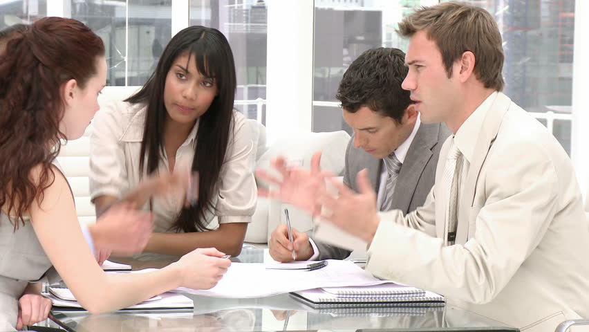 Serious brainstorming of business people in a company - HD stock video clip