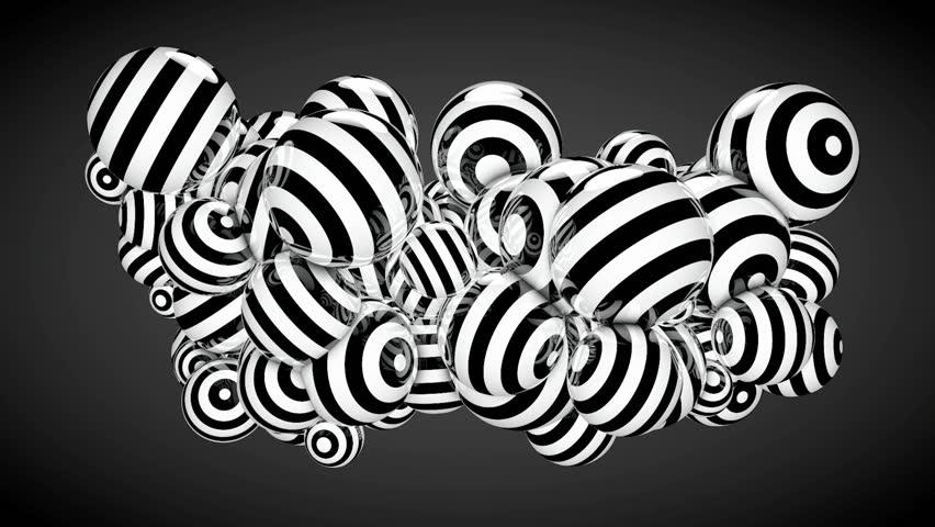 Looping shiny balls on black background
