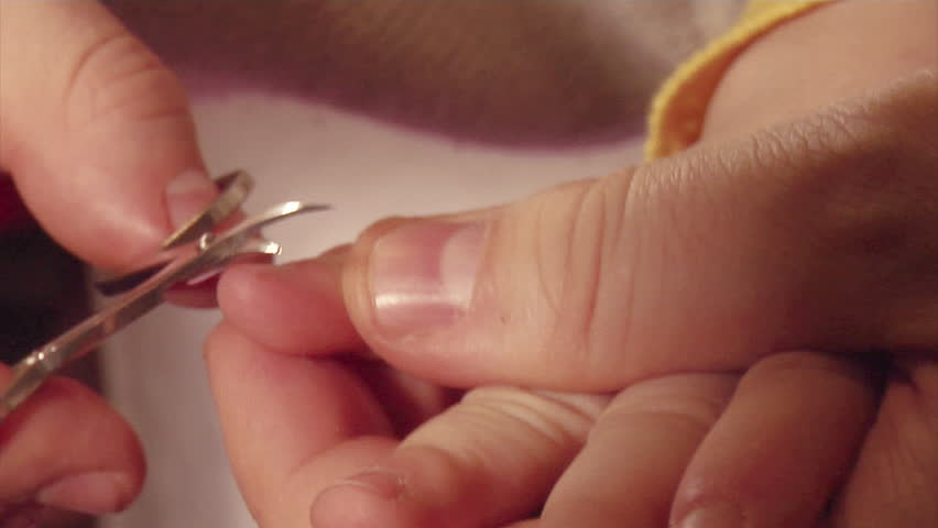 cutting nails for child - HD stock footage clip