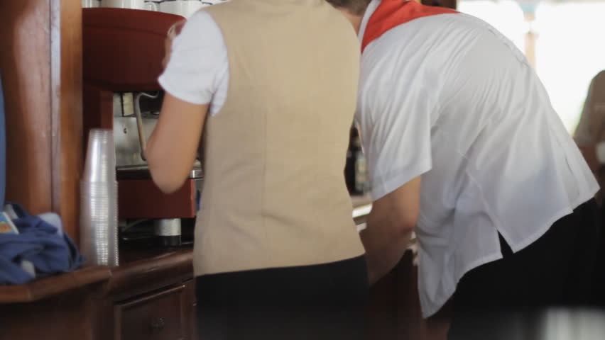 Very Busy Bar Staff In A Hotel Making Cappuccino Coffee