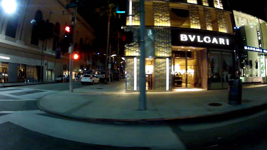 BEVERLY HILLS, CA: March 11, 2014- Shot of night driving by expensive designer stores on Rodeo Drive circa Beverly Hills. Night view of pricey, exclusive name brand stores of popular designers.