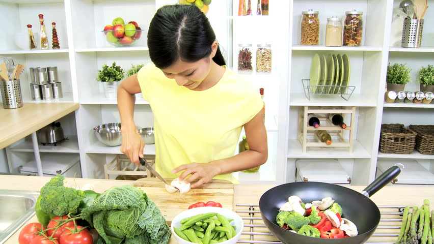 Asian Chinese Girl Kitchen Preparing Healthy Lunch - Young Asian Chinese girl home kitchen preparing to cook healthy fresh vegetable ingredients low fat stir fry lunch