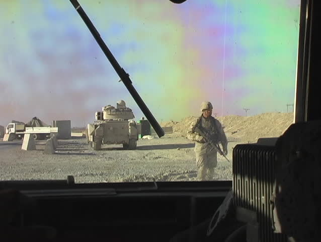 Iraq, Circa 2005: Bradley Armored Vehicle and Marine on Patrol, seen from inside a Humvee in Iraq, Circa, 2005