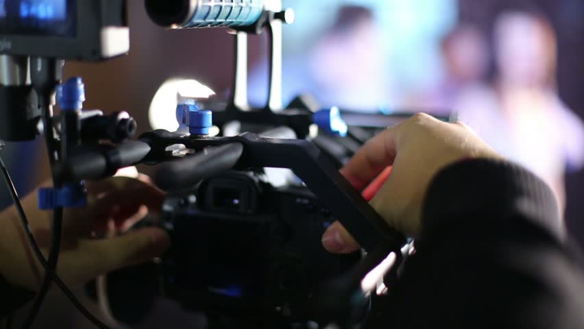 RUSSIA, MOSCOW - FEB 21, 2013: Director install camcorder and prepare Eugeniya Vershanskaya on the set before shooting clip in studio Factory - HD stock footage clip