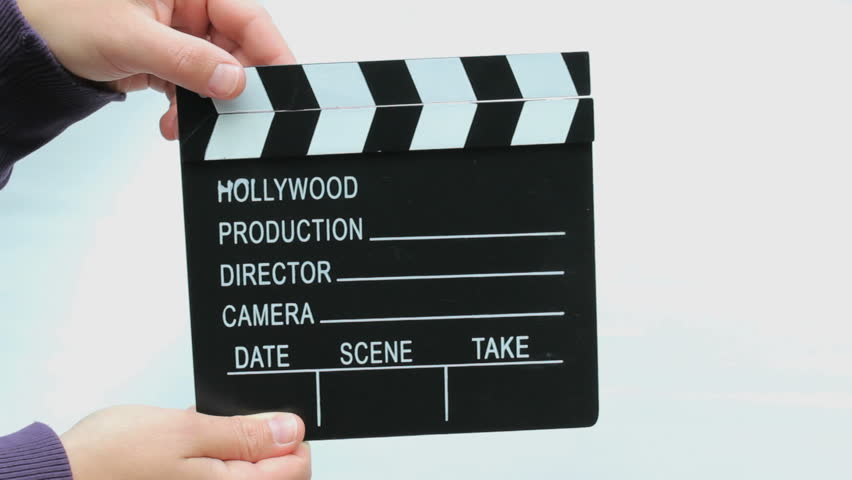 Using a clapperboard with female hands