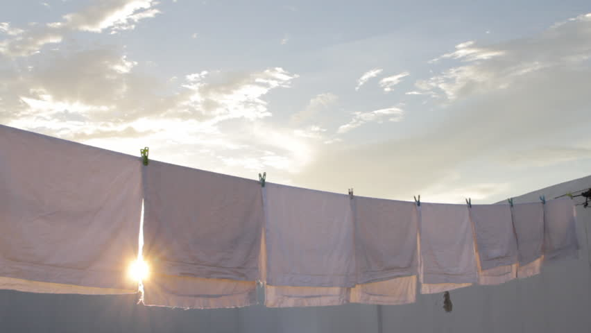 White laundry drying on clothesline against blue sky stock footage video 6653240 shutterstock - Wash white sheets keep fresh ...