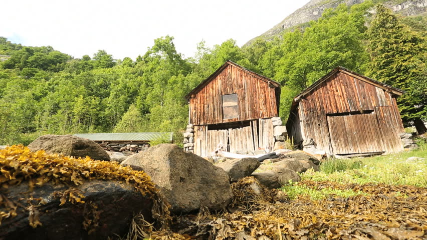 Geiranger old part of the town wood built small houses boathouses