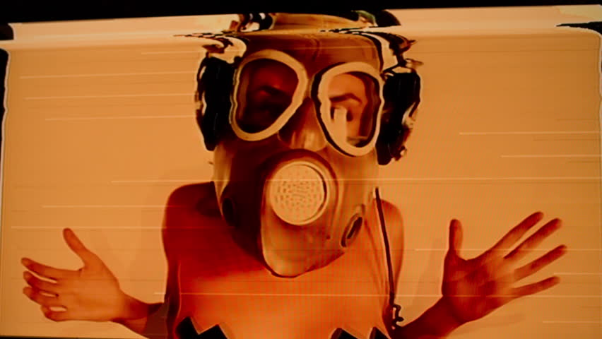 sexy woman with beautiful body dances with a gas mask covering her face. Good clip for party, fetish, industrial or warfare. Intentional added video distortion