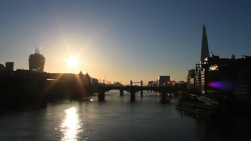 City of London skyline at sunrise. Tower Bridge, Thames River and The Shard. Beautiful morning.