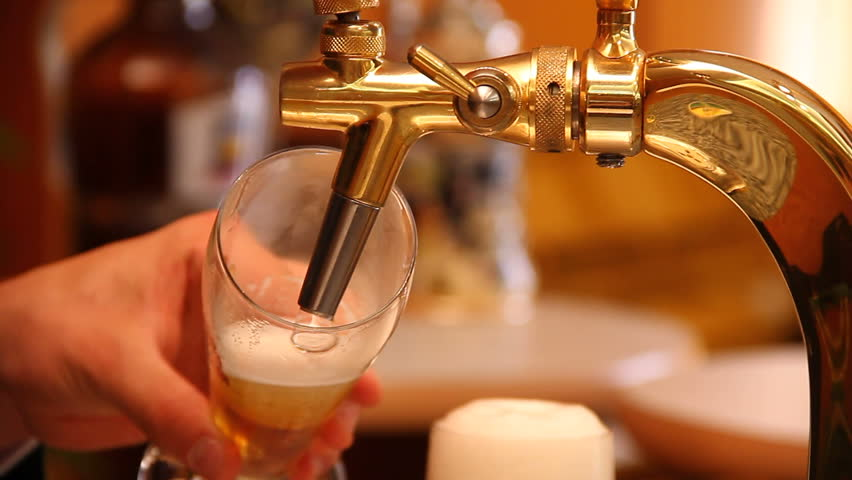 Tapping a beer in a bar - original footage, not color corrected.
