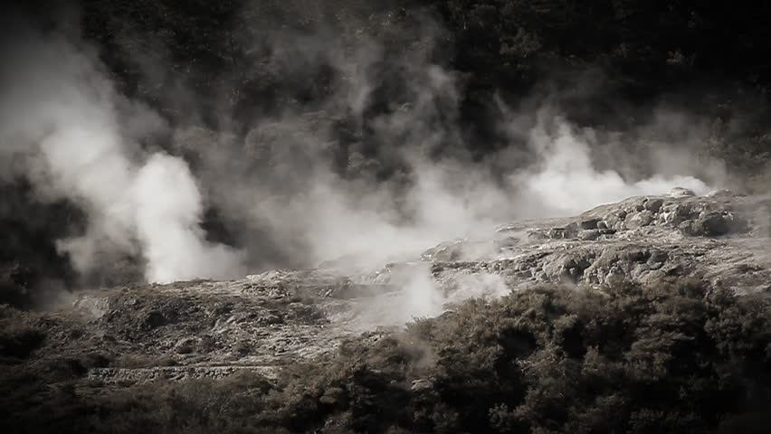 Slow motion. Geothermal area at Rotorua New Zealand. Hot springs, silica terraces, and steaming vents at Whakarewarewa Thermal Park - one of NZ's top tourist attractions. Monochrome tinted footage.
