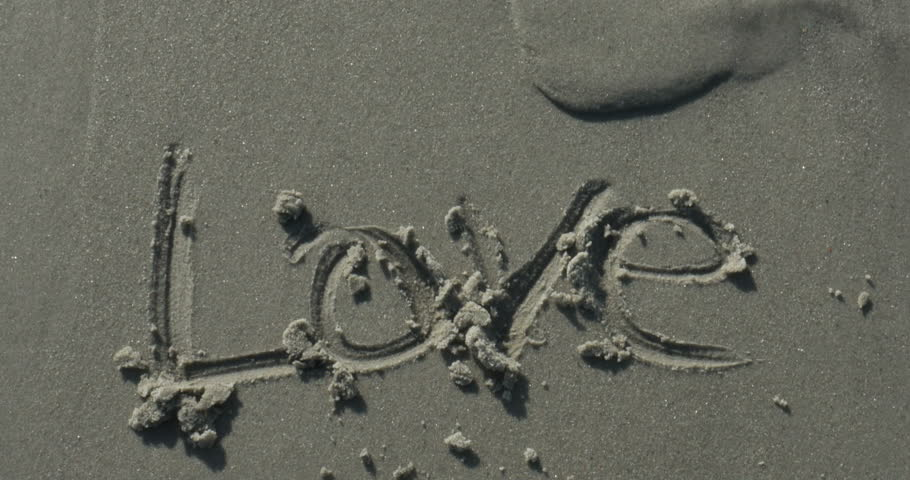 Love Written in the Sand at the Beach - 4K stock footage clip