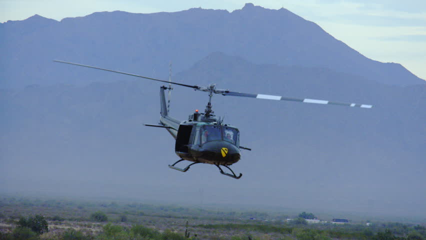 Huey helicopter banks left. - HD stock video clip