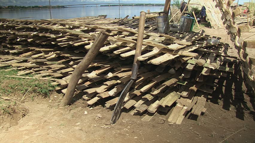 Bamboo hatchet and a stack of bamboo floors on the riverbank,, southeast asia , cambodia