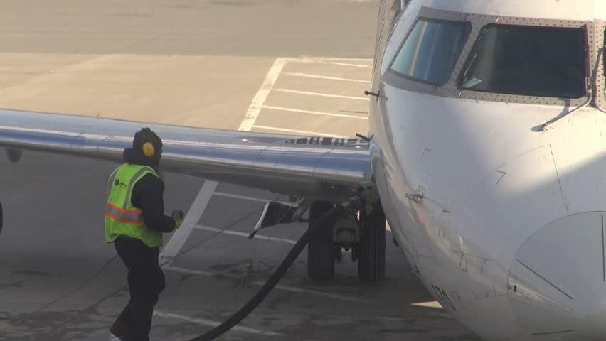 SYRACUSE, NEW YORK – JANUARY 10 2014: Refueling an Airplane on January 10 2014 in Syracuse, New York