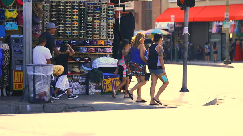 Los Angeles, California - September 7, 2014: Crowd of Shoppers and tourists at Sunglasses Hut in Fashion District Market September 7, 2014 in Los Angeles, California.